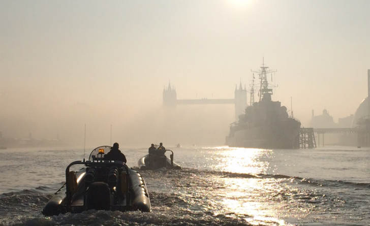 Rib charter on the Thames on a foggy morning approaching Tower Bridge