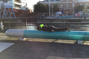 Sarah planking on torpedo